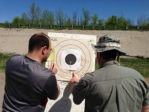 Scoring an NRA timed/rapid fire target during a match at Connaught.